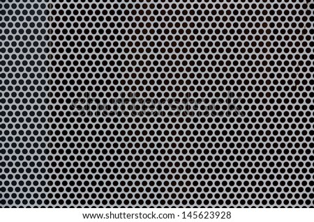 Background of gray metal with perforated holes - stock photo