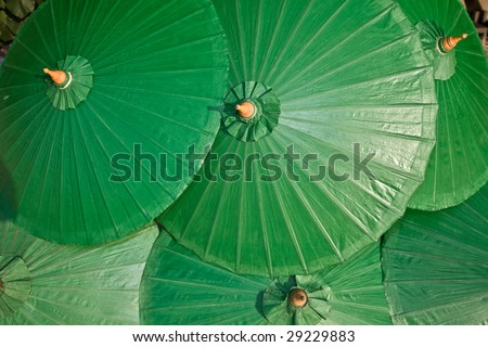 Background of green chinese umbrella. Design. - stock photo