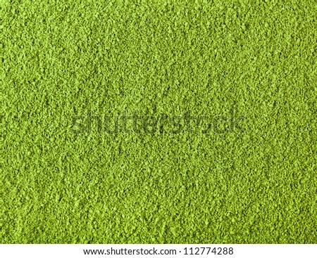 Background of green powder surface close up macro shot  - stock photo