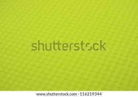 background of green yoga matt - stock photo