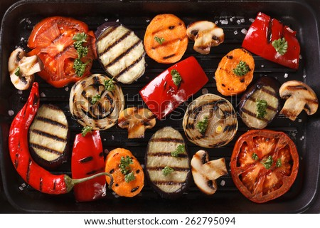 Background of grilled vegetables on a grill close up. horizontal view from above  - stock photo