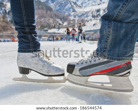background of group ice skates, standing opposite each other - stock photo