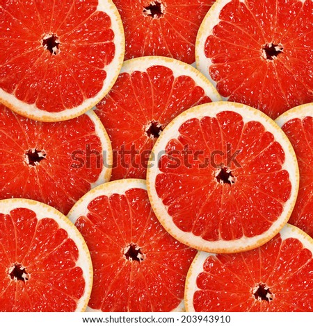 background of heap fresh red grapefruit slices - stock photo