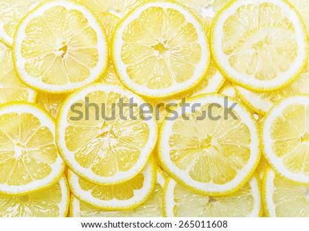 background of heap fresh yellow lemon slices - stock photo