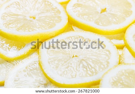 background of heap fresh yellow lemon slices. focus in the middle of the frame, shallow depth of field - stock photo