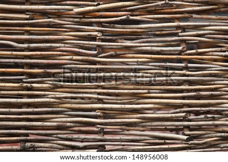 Background of interwoven wooden bars - stock photo