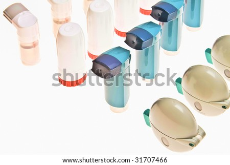 Background of isolated Colored plastic inhalers - stock photo