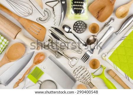 Background of kitchen utensils on wooden kitchen table - stock photo