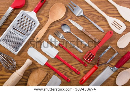 Background of kitchen utensils on wooden kitchen table - stock photo