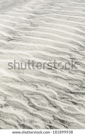 Background of light and dark beach sand: Rippled pattern created by the wind, St. Augustine, Florida, USA - stock photo