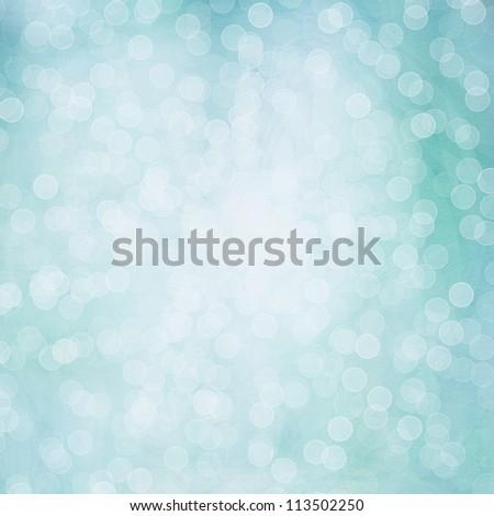 Background of light blue colors. Beautiful shiny Christmas lights, glowing magic bokeh. - stock photo