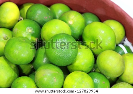 background of limes in a basket