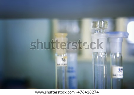 Background of long flasks and laboratory test tubes in laboratory