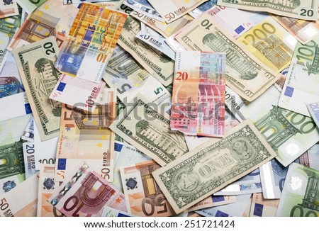 Background of lots of bills of mixed currency and value of euro, dollars and swiss francs - stock photo