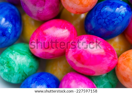 Background of many colored eggs on easter - stock photo