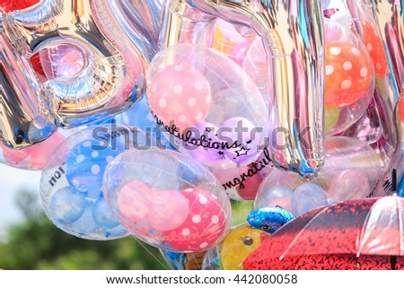 background  of many colorful balloons outdoors - stock photo