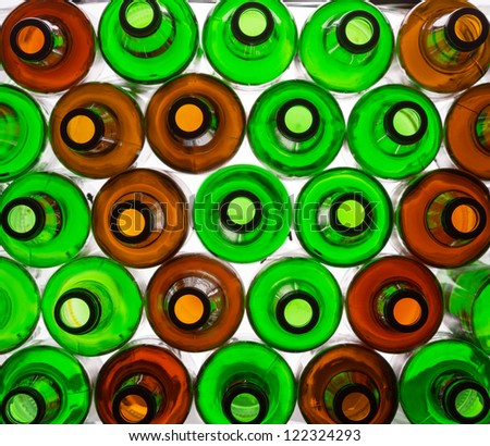 Background of many colorful glass bottles
