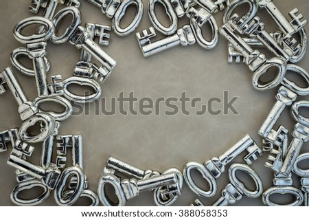 background of many gray keys on leather background with copy space in center