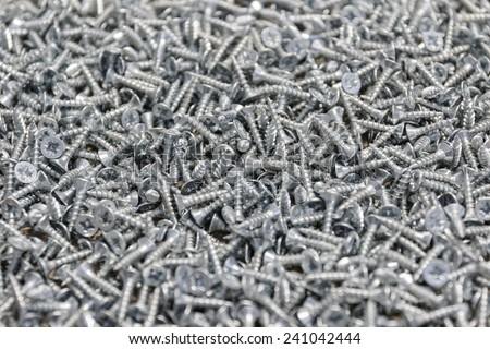 Background of many screws - stock photo