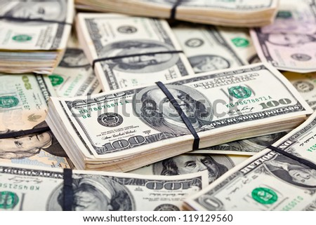 background of many US dollars banknotes - stock photo