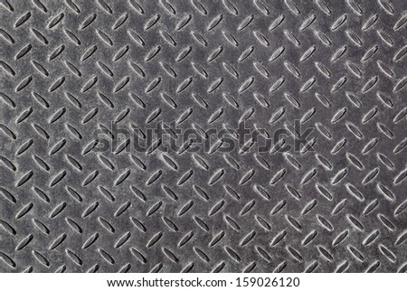 Background of metal diamond pattern plate - stock photo