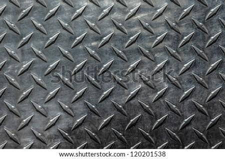 Background of metal diamond plate - stock photo