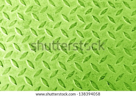 Background of metal diamond plate in green color. - stock photo