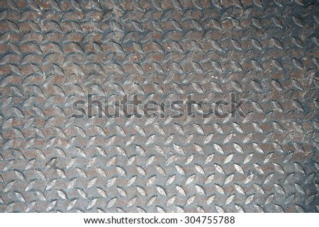 Background of metal diamond plate in grungy - stock photo