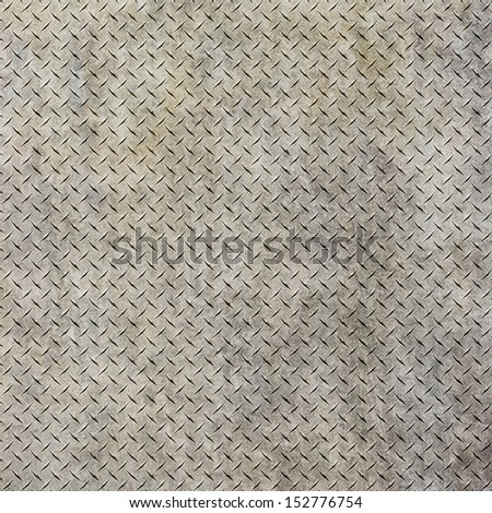 Background of metal diamond plate in grungy color. - stock photo