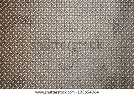 Background of metal diamond plate in silver color - stock photo