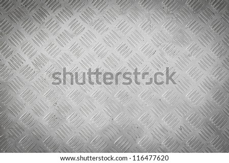 Background of metal diamond plate pattern. - stock photo