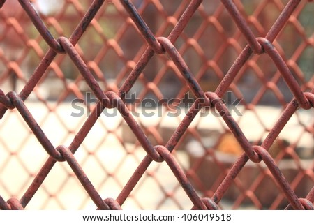 background of Metal mesh fence painting red