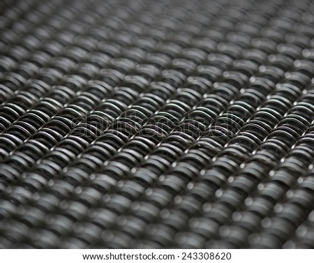 Background of metal springs for making binding - stock photo