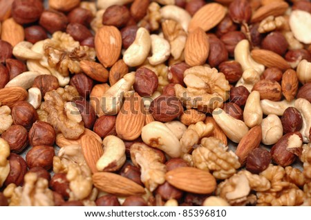 Background of mixed nuts - pecans, hazelnuts, walnuts, cashews, almonds, pine nuts, pistachios, - stock photo