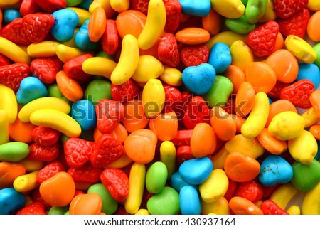 Background of multicolored stone shaped candies - stock photo