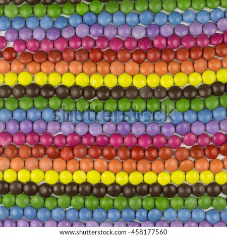 background of multicolored sugar coated candies - stock photo