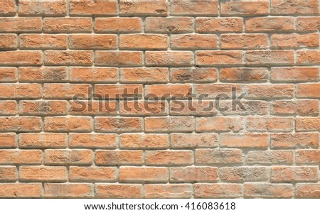 Background of old and dirty vintage orange brick wall, new paint old brick wall, dilapidated brick wall, strong brick wall for background texture - stock photo