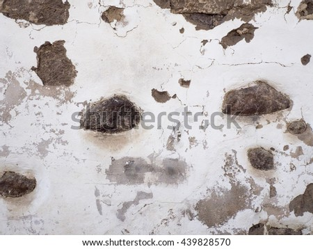 Background of old damaged stone wall texture