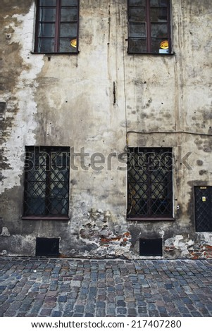 Background of old grungy wall with windows - stock photo