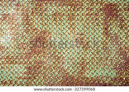 Background of old metal diamond plate in green and brown colour - stock photo