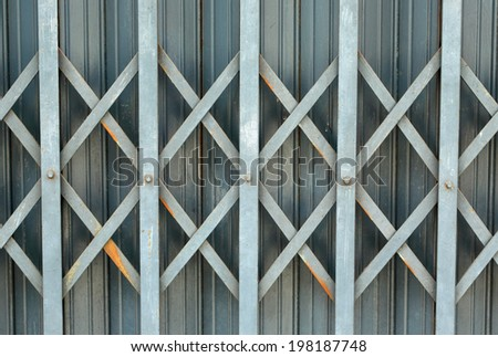 Background of old metal door in grungy style - stock photo