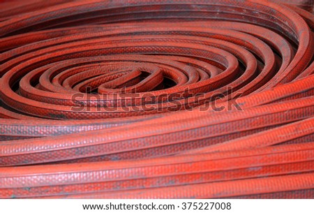 background of old red firehose and dirty - stock photo