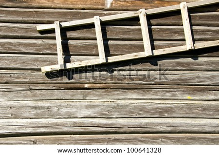 background of old retro log house wall and wooden ladder hanging.