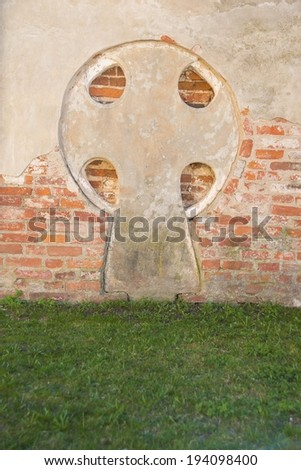 Background of Old retro red brick Wall With Cross and green summer grass floor - stock photo