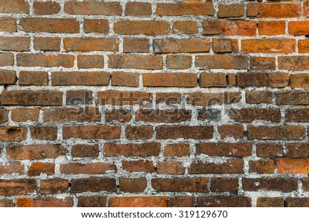 Background of old vintage brick wall. - stock photo
