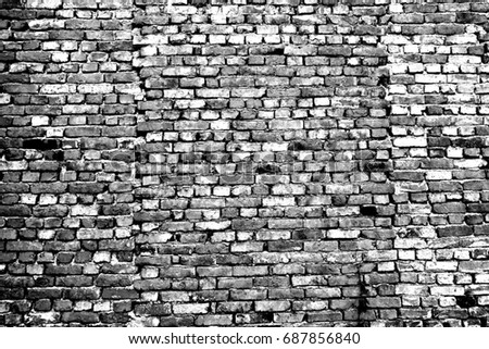 Background of old vintage brick wall. Image includes a effect the black and white tones.