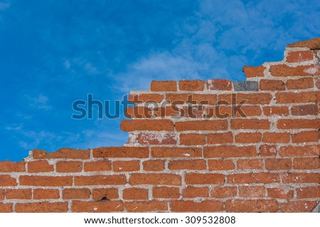 Background of old vintage brick wall, Wallpaper Pattern and blue sky - stock photo