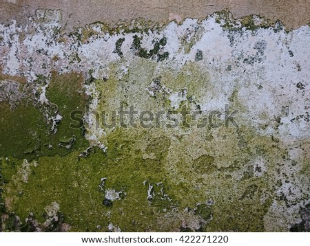 background of old weathered decaying wall with interesting irregular pattern - stock photo