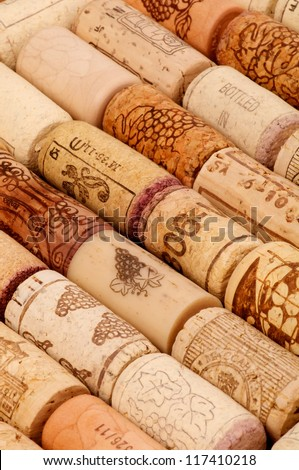 Background of Old Wine Corks in a Row closeup - stock photo