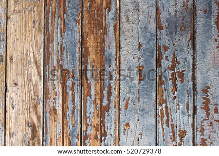 Background of old wooden boards with worn blue paint